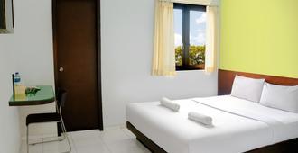 Legreen Suite Ratulangi - Ambon - Bedroom