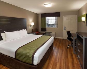 Days Inn & Suites by Wyndham Athens Alabama - Athens - Ložnice