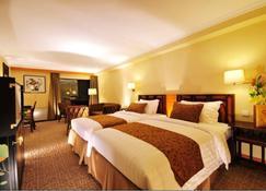 지안구오 호텔 시안 - 시안 - 침실