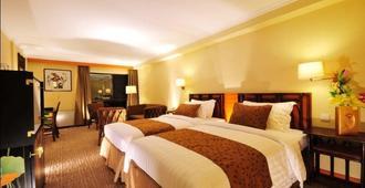 Jianguo Hotel Xi An - Xi'an - Schlafzimmer