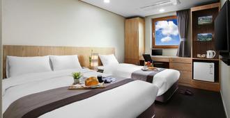 Golden City Hotel Dongdaemun - סיאול - חדר שינה