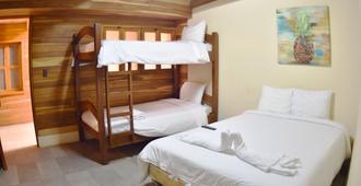 Casa Aura Beachfront Premium Hostel - Tamarindo - Habitación