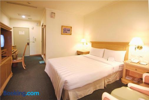 Cambridge Yang Kang Hotel - Tainan - Bedroom
