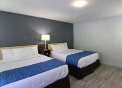 Travelodge by Wyndham Downtown Gatlinburg - Gatlinburg - Bedroom