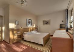 麗城沃德海姆酒店 - 布列瑟農 - 布列瑟農 - 臥室