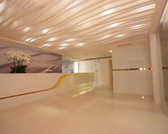 Hotel Purity - Xinzhuang District - Front desk