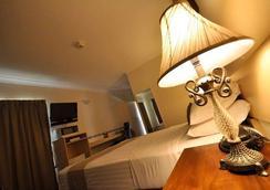 Emerald Maraboon Motor Inn - Emerald - Bedroom