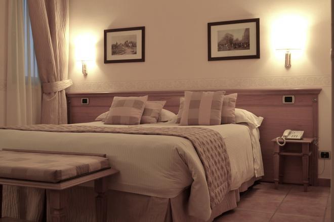 Seccy Hotel Boutique - Fiumicino - Κρεβατοκάμαρα