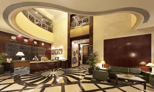 阿爾門澤爾公寓酒店 - 阿布達比 - 阿布達比 - 櫃檯