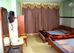 Hotel Charu - Barisāl - Phòng ngủ