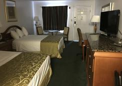 Magic Castle Inn and Suites - Kissimmee - Makuuhuone