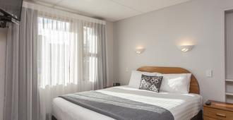 Amross Motel - דנידין - חדר שינה