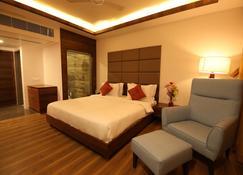 Motel The Village Resort - Rajkot - Bedroom