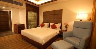 Motel The Village Resort - Rajkot - Habitación