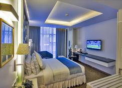 Grace 21 Smart Hotel - ธากา - ห้องนอน