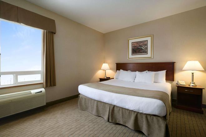 Days Inn by Wyndham Moose Jaw - Moose Jaw - Κρεβατοκάμαρα