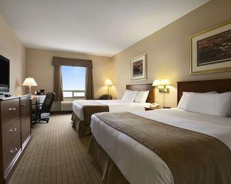 Days Inn by Wyndham Moose Jaw - Moose Jaw - Bedroom