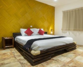 Hotel Posada Jarritos - Куэцалан-дель-Прогресо - Спальня