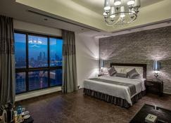 Loumage Hotel & Suites - Manama - Habitación