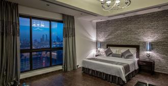 婁瑪吉酒店及套房 - 麥納麥 - 臥室