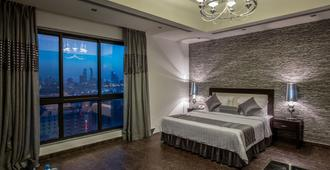Loumage Hotel & Suites - מאנאמה - חדר שינה