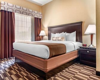 Best Western Plus Victor Inn & Suites - Victor - Спальня