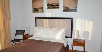 Hostal Los Frayles - Paracas - Phòng ngủ