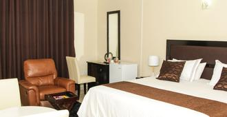 Streets of Gold Guest House - Gaborone - Schlafzimmer