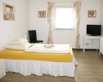 Haus-Am-Muehlenbach - Stadthagen - Schlafzimmer