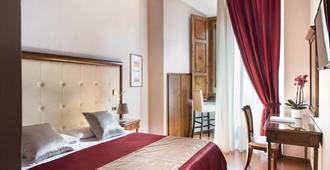 Hotel Leon Bianco - סן ג'ימיניאנו - חדר שינה