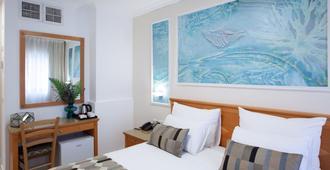 מלון ארמון הירקון - תל אביב - חדר שינה