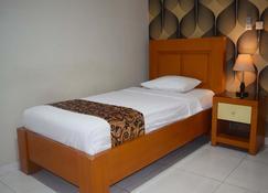 Megaria Hotel - Merauke - Bedroom