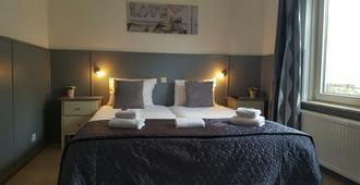 Hotel Dupuis - ואלקנבורג אן דה גול - חדר שינה