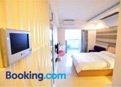 Nanning Qingzhou Rental Apartments - Nanning - Schlafzimmer