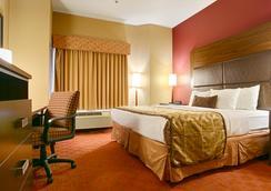 西方最佳加鄉村山套房酒店 - 土爾沙 - 圖爾薩 - 臥室