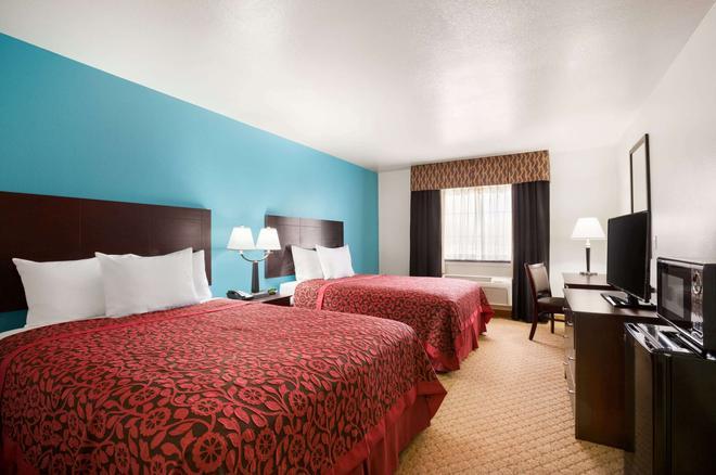 Days Inn & Suites by Wyndham Conroe North - Conroe - Bedroom