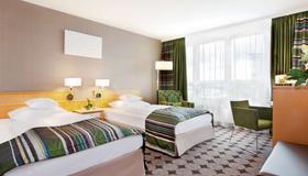Mövenpick Hotel Nürnberg Airport - Nuremberg - Bedroom