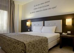 โรงแรมเอ็กเซกคิวทีฟ - เซียน่า - ห้องนอน