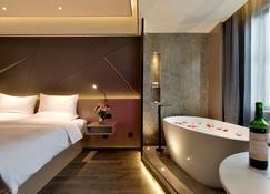 太原丽华龙湾温泉酒店 - 太原 - 臥室