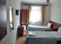 Hekimoglu Otel - Erzurum - Schlafzimmer