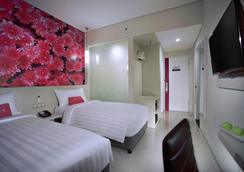 龍目島蘭科馬塔蘭菲芙飯店 - 馬塔蘭 - 臥室