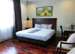 Bloom Boutique Hotel & Cafe - Vientiane - Bedroom