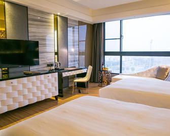 Sun Hao International Hotel - Dǒuliù - Slaapkamer