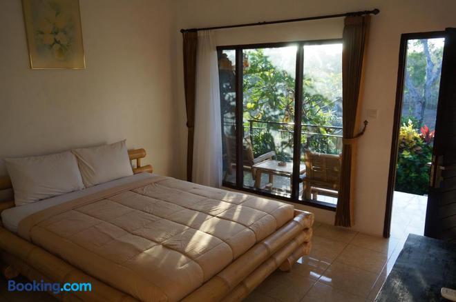 Willy Homestay - South Kuta - Bedroom