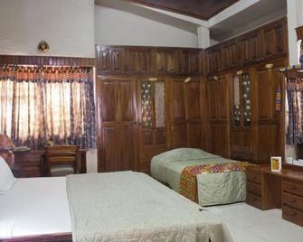 Four Villages Inn - Kumasi - Bedroom