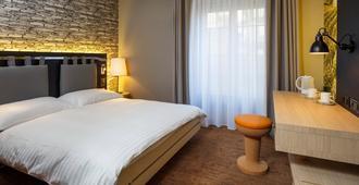 سويس واين باي فاسبايند - لوزان - غرفة نوم