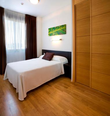 Compostela Suites Apartments - Madrid - Schlafzimmer