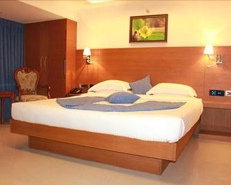 Moskva Hotel - Madurai - Slaapkamer