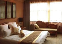 S&n Niutoushan Resort - Taizhou - Bedroom