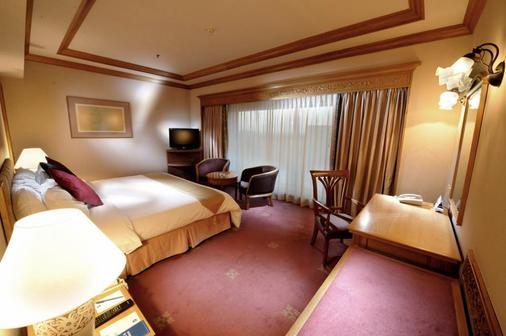 濱江大飯店 - 古晉 - 臥室